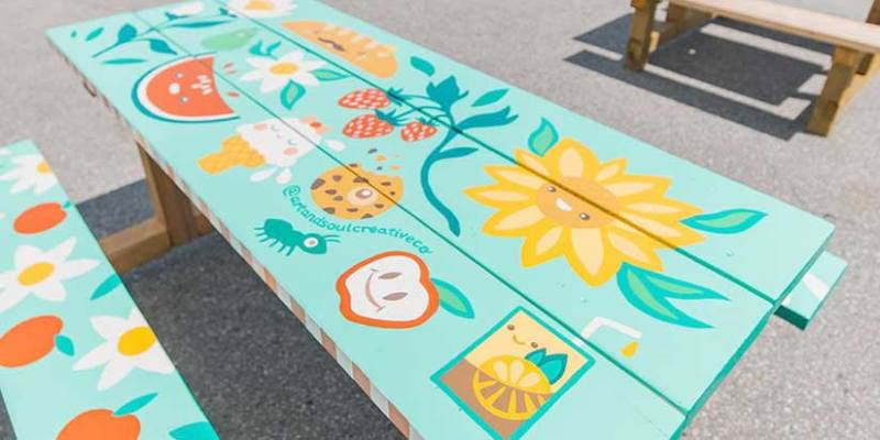Artists have a picnic painting pop-up tables